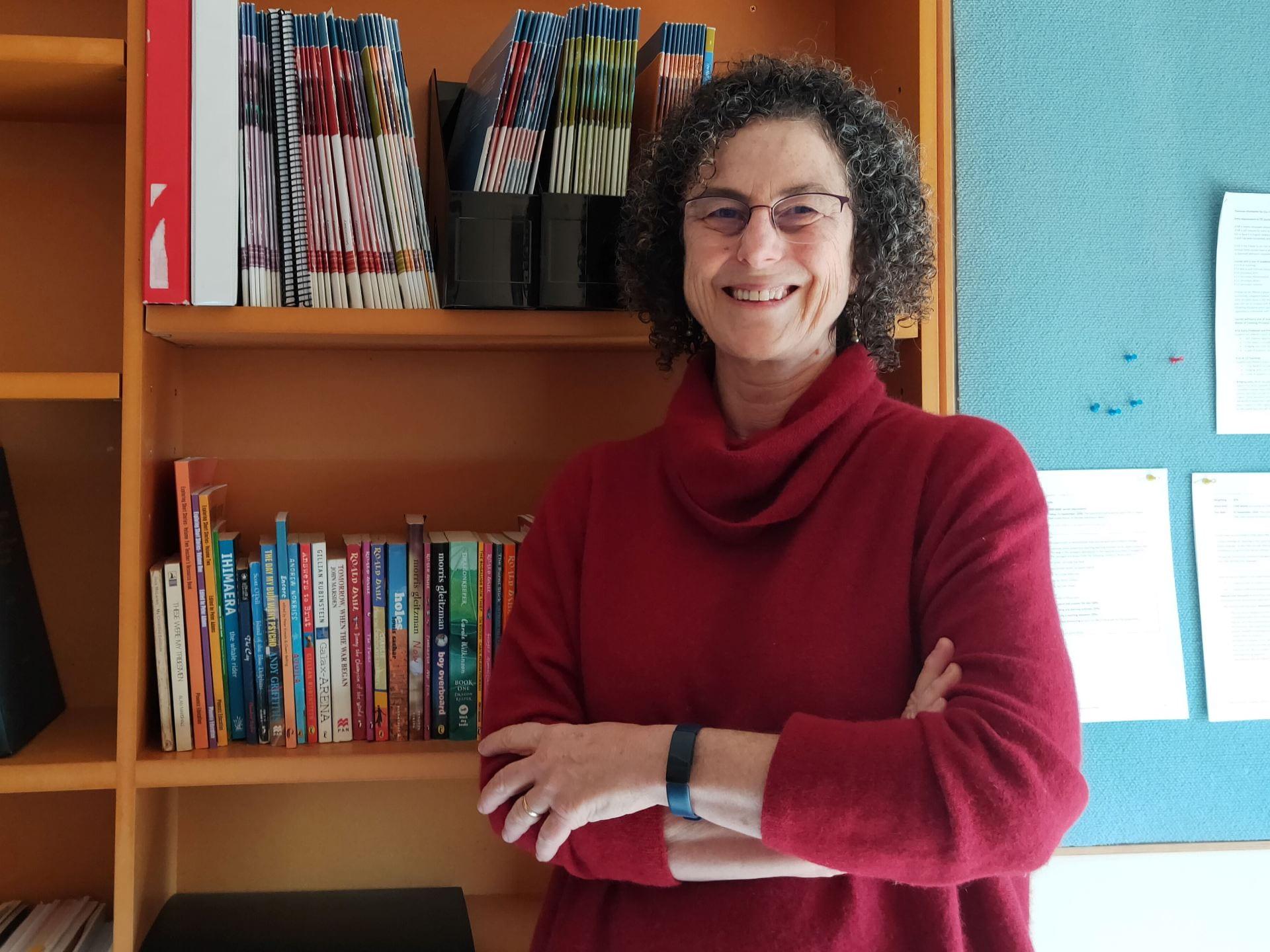 Portrait image of Helen Harper in front of a bookshelf