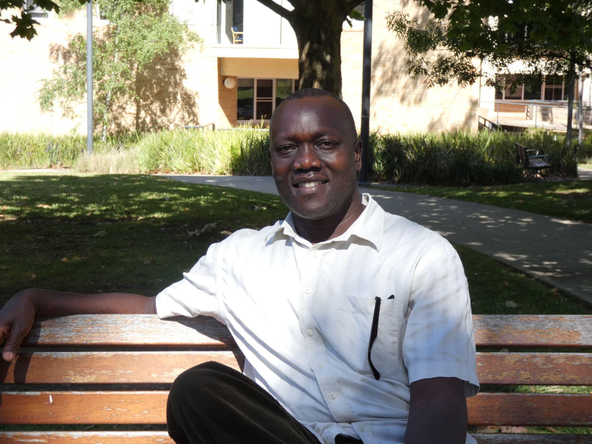 Casual portrait image of peace studies PhD candidate Sam Onapa