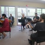 The band performing the composition in its entirety for the first time during rehearsal