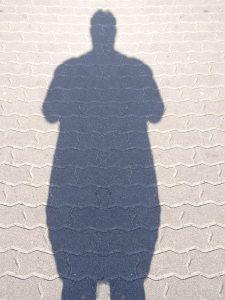 fat-shadow-man-1168363-1279x1705