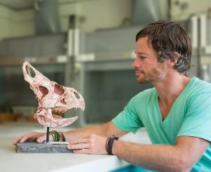 Phil Bell examining a dinosaur skull
