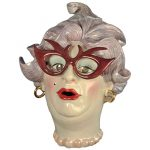Ceramic tea pot, created by Suzzane Hatch, that represents Barry Humphries.