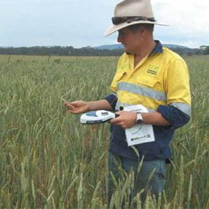 Man with wireless monitoring system in the field.