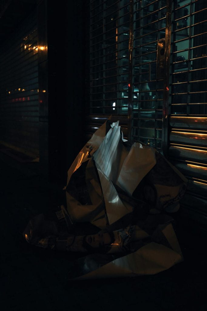 Dark background, blinds in the background