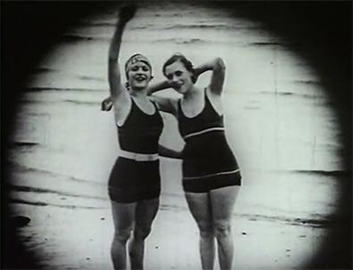 Two women on beach in A Takapuna Scandal (1928).