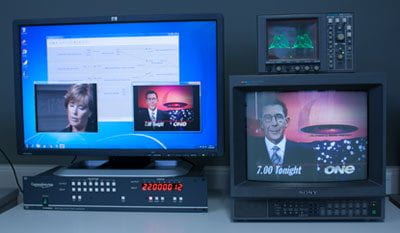 Media Services equipment used to digitise content from older formats, with televisions showing footage from previous TV broadcasts, including Sir Paul Holmes.