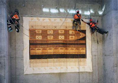 Abseilers installing artwork