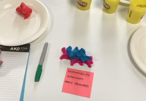 A playdough model depicting the difficulty of walking in two worlds.