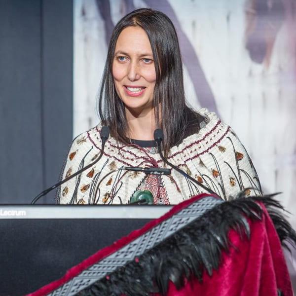 Jacinta Ruru speaking at a podium