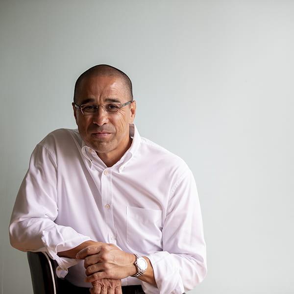 Headshot of Paul Majurey sitting on a chair