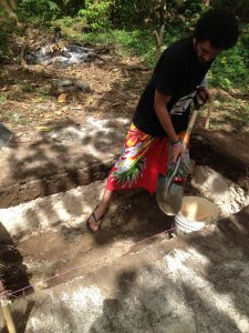Mana Laumea rippin' out Layer III! (bonus points for wearing a lavalava during excavation). That clean white sand is the 2009 tsunami deposit.