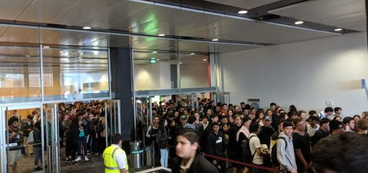 A massive crowd of sweaty engineers are herded into a lecture theatre, like cattle