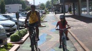 Dad and daughter biking in Rotorua