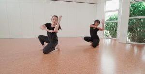 Image of two dancers in studio