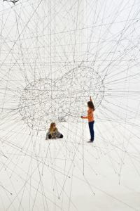 Two people inside a network of lines