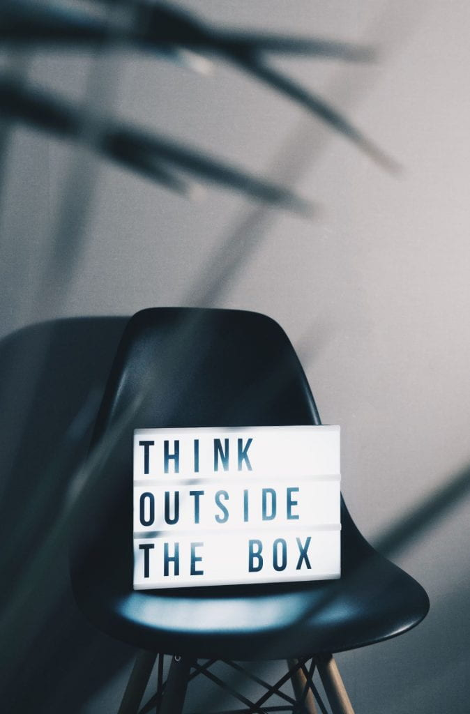 "Light box with text saying ""think outside the box"""