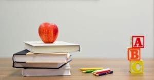 Apple, books, pencils and ABC blocks