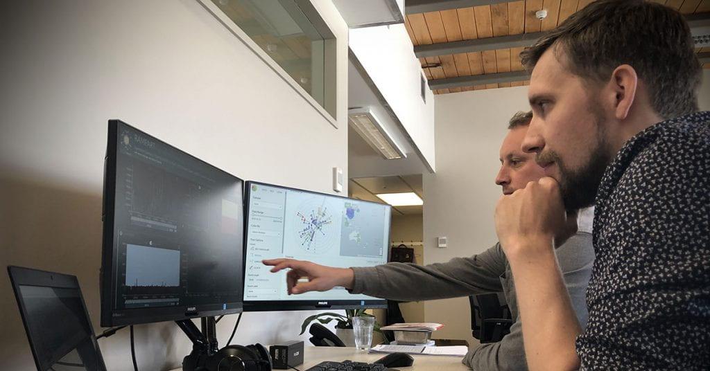 ESR scientists Joep de ligt and Matt Storey look at a computer screen