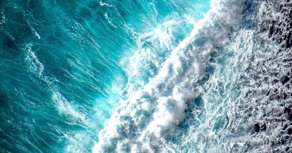 Aerial photo of an ocean wave breaking