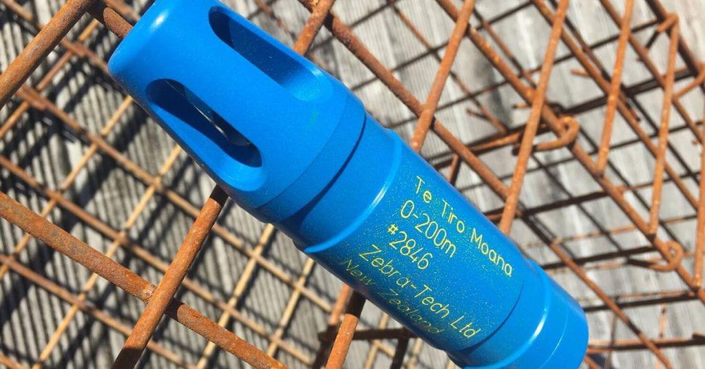 A plastic blue temperature sensor attached to the top of a rusty metal cray pot