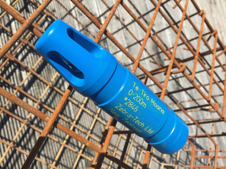 A blue plastic temperature sensor attached to the top of a metal cray pot
