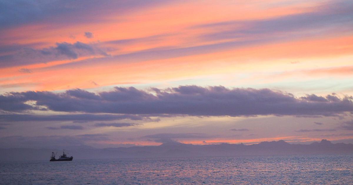 A fishing vessel off the coast of Coromandel at sunset