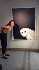 """A visitor enjoying the exhibition """"The Universe Looks Down."""""""