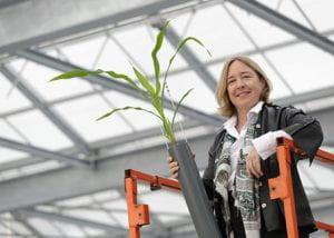 Michelle Watt with a green leafy plant