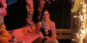 Bonnie drinking a margarita at the new tiki bar she and her husband built on the balcony of their house in LA.