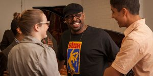 Christian McBride chats with students after the masterclass.