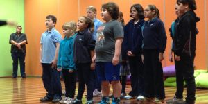Children perform the Short Black Opera