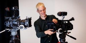 Film and Television student Gabriel Hutchings adjusting film equipment.