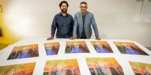 Trent Walker and Jon Cattapan in the VCA screenprinting workshop with prints by Jon Cattapan. Photo by Sav Schulman.