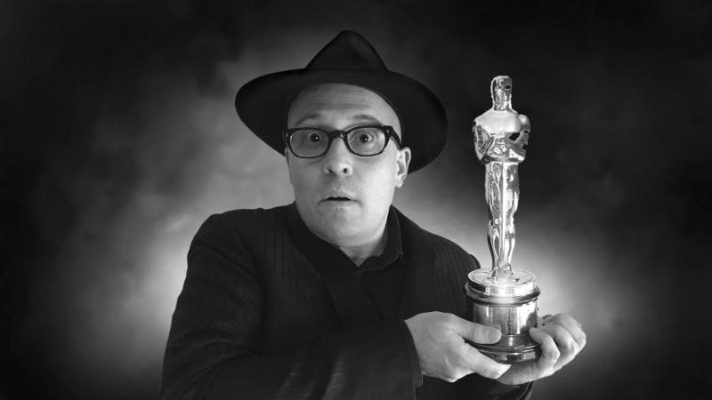 Adam Elliot with his Oscar