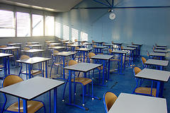 A traditional classroom where students sit for 5-6 hours a day.