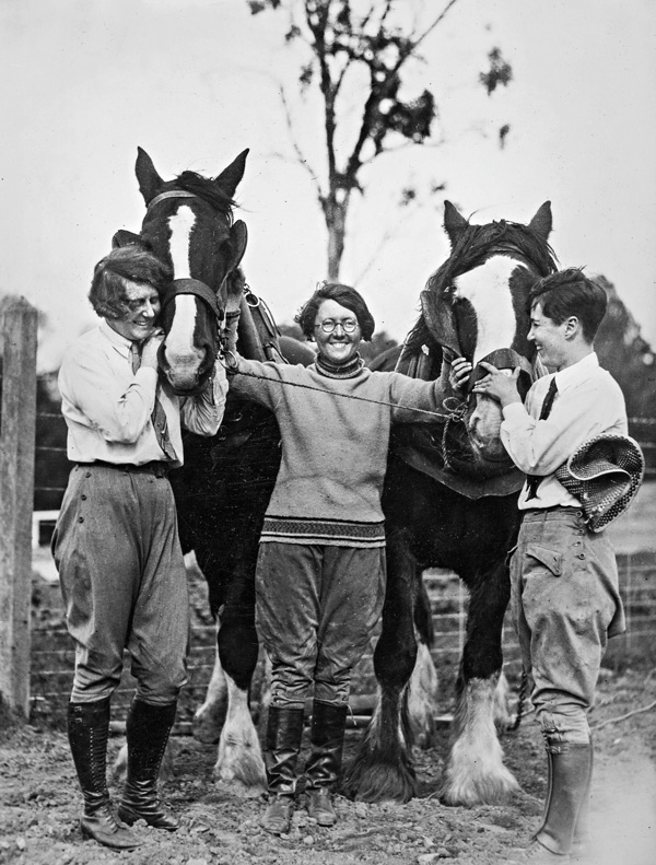 Students with the campus draught horses in the 1920s.