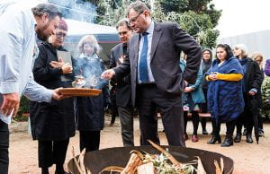 Professor Duncan Maskell lighting a flame.