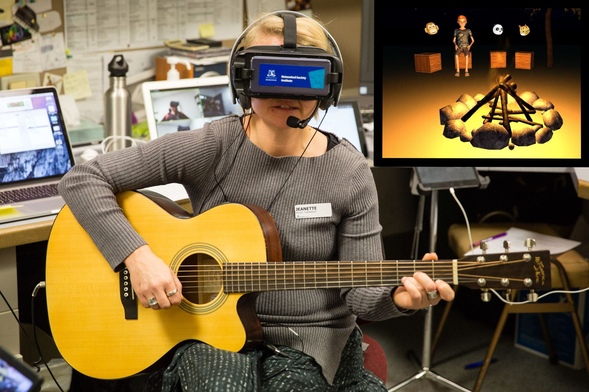 Music therapist playing guitar and singing whilst wearing virtual reality headset
