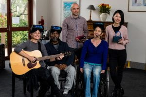 Group of music therapy researchers and participants wearing virtual reality headsets