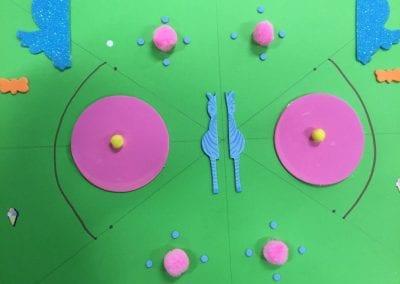 A symmetrical design involving zebra halves and pink circles