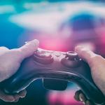 Video game literacy through design